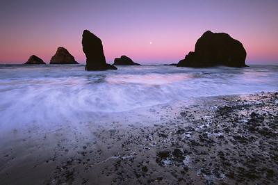 Moonset over Three Arch Rocks