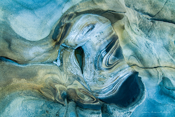 Erosion swirls in a blue pool
