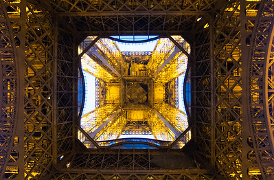 Looking up through the Tour Eiffel (the Eiffel Tower), Paris, France