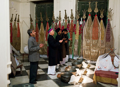The Raja along with companions conducts the Nazar (dedication) at the Baradari in Mahmudabad. The Baradari is a large room in the Qil'a, or palace, of Mahmudabad which contains an area for delivering religious sermons as well as sections for specific rituals and observances.