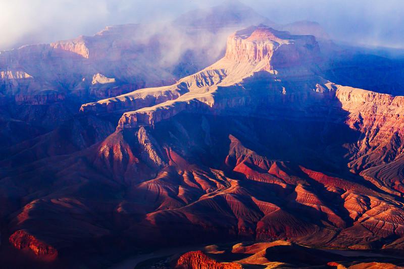 Misty sunset on canyon wall of Grand Canyon National Park, Coconino County, Arizona