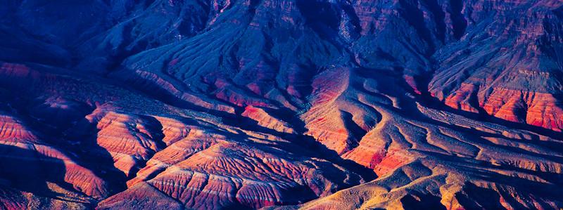 Sunset on hills above Colorado River, Grand Canyon National Park, Coconino County, Arizona