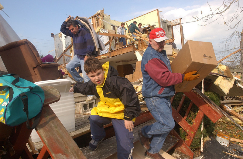 (R-L) Jim Henney, Phillip Spitler, and Steve Spitler help salvage items at Ed and Theresa Spitler's home at 3617 Northeast Catawba Road in Catawba Island Township outside of Port Clinton, Ohio.  Their home was a total loss to the storms on Sunday night.<br /> Photo Ben French<br /> The News Messenger<br /> 11/11/02