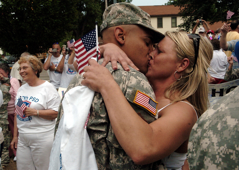 Sgt. Jacob Morgan is greeted with a kiss by his fiance, Cara Rothe, outside of Canal Winchester Middle School last Friday during a welcome home ceremony for the Columbus based 437th Personnel Service Detachment of the Ohio National Guard.
