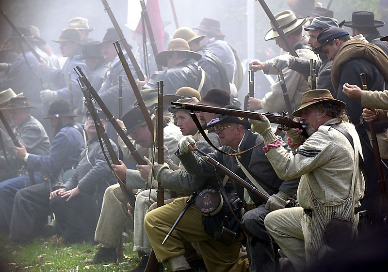 The Confederate army fires at the Union at the Civil War encampment on saturday.<br /> Photo Ben French