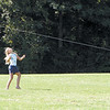 """News photo by Ben French<br /> <br /> Spirits are soaring<br /> Nine-year-olds Sarah Both (left) and Natalie Bayer attempt to fly a kite at Thompson Park during the Upper Arlington Parks and Recreation Department's """"Family Kites and Flight"""" event Saturday morning."""