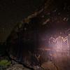 Fremont hand-in-hand petroglyphs, night sky, Utah