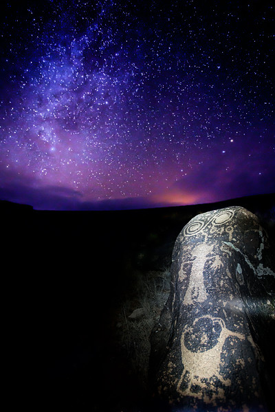 Ancestral Pueblo petroglyphs under the night sky, Utah