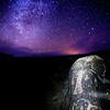 Ancestral Pueblo petroglyphs under the night sky, Utah