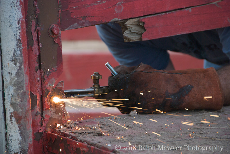 Crew repairing the bull rider's bucking chute in preparation for the 2007 Kendall County Fair Rodeo, Boerne, Texas