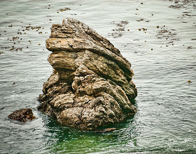 Rock of the Face, Face of the Rock, and the Sea All Around