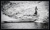 """NATIVE AND MOKORO CANOE"" - NATIVE WITH A MOKORO DUGOUT CANOE THAT WAS FISHING IN THE CHOBE NATIONAL PARK IN BOTSWANA, AFRICA"