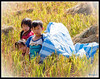 """CHILDREN PLAYING IN A RICE PADDY"""