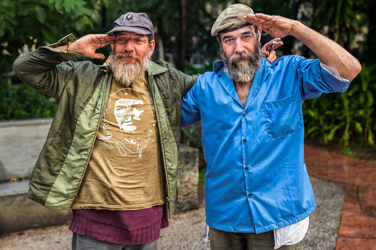 Che Guevara fan and Fidel Castro lookalike offer salutes in Havana, Cuba