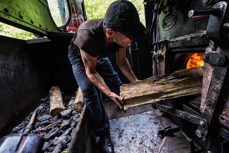 Humitar Brender loads the steam engine near Viseu de Sus, Romania