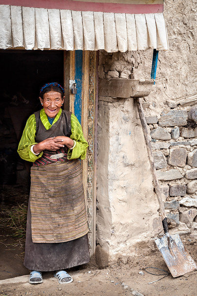 Woman at the entrance to her home in Shigatse, Tibet