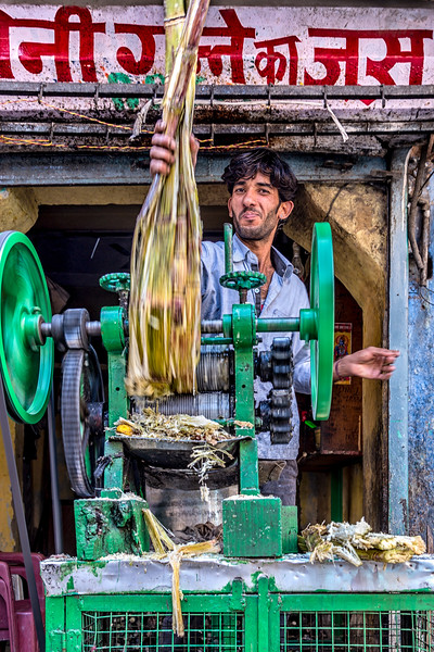 Street vendor making juice from fresh sugar cane in Jodhpur, India