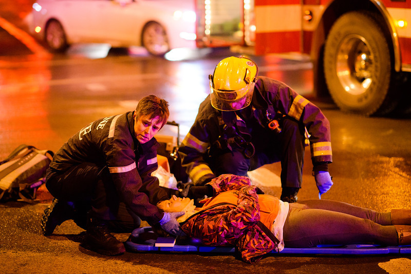A bicyclist and car collided at the intersection of 18th & Hilyard in Eugene, Ore. on Jan. 6, 2014. The female bicycle rider was taken from the scene on a stretcher with protective head restraints, and the male driver of the maroon Ford Taurus LX car was returning to work at Dough Co. before the accident.
