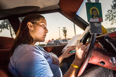 Homeless student Nina Waldez studies in her car near the campus as night falls. Nina spends months at a time living out of her car, finding safe parking spots to overnight and fending off harassment by homeless men. Yet she maintains a 3.0 GPA without textbooks.