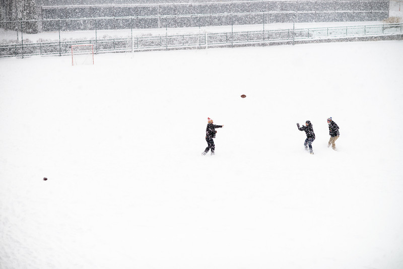 A group of students play a friendly game of football on the deserted University of Oregon student recreation fields. Several inches of snow fell overnight in Eugene, Ore. on Dec. 6, 2013.