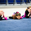 A trio of gymnasts await their teammate's performance during the Classic Rock competition at Cardinal Stadium in Glendale, Ariz. on Feb. 20, 2011.