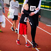 Ten year old Kyle Peterson clutches his father Kyle's waist after pair finished their second 5K together with times of 26:03 and 26:02, respectively. Kyle is a professor of accounting at the University, and he last ran with his son during the 2012 Eugene Turkey Stuffer run. The 4th annual Run With The Duck 5K kicked off at Hayward Field in Eugene, Ore. on Nov. 9, 2013.