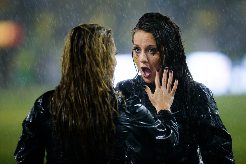 An Oregon cheerleader receives help with her makeup during the torrential downpour in the first half. The No. 2 Oregon Ducks play the California Golden Bears at Autzen Stadium in Eugene, Ore. on Sept. 28, 2013.