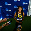 Oregon's English Gardner is swarmed by the media in the post-race press conference area after she won the women's 100 meter race with a time of 10.96 during the NCAA Track and Field Championships at Hayward Field in Eugene, Ore. on June 7, 2013.