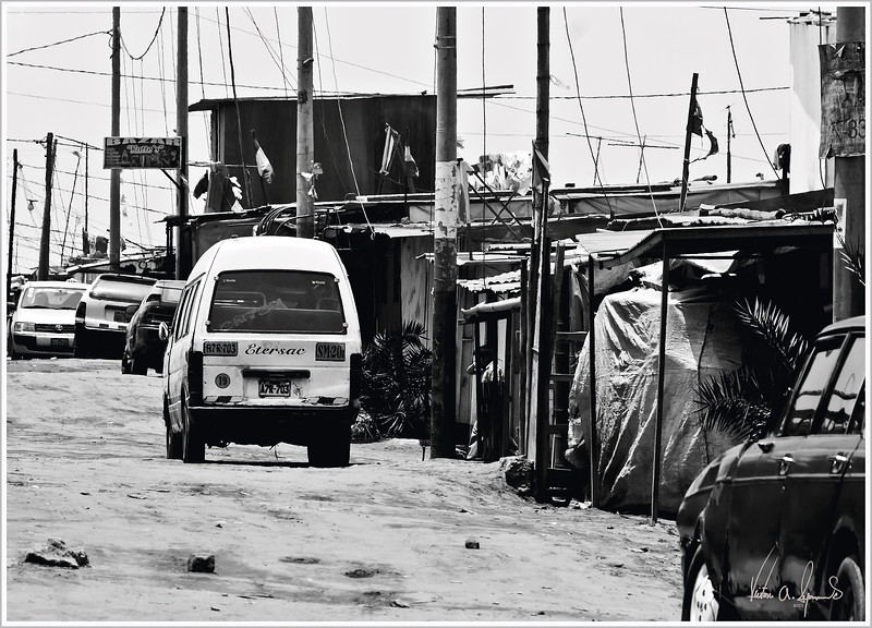 """SHANTY TOWN STREET"" - LATE MORNING IN VILLA EL SALVADOR (A SHANTY TOWN), NEAR LIMA , PERU ON NOVEMBER 13, 2011"