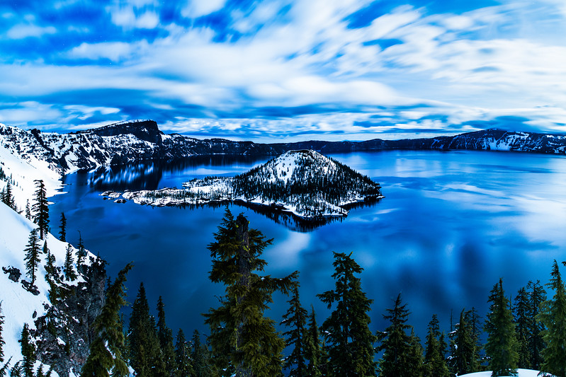 Crater Lake's Wizard Island is illuminated by a full moon near midnight on March 27, 2013.