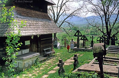 [ROMANIA.MARAMURES 23.692] 'Church with a view.'	 At the medieval wooden 'Church on the Hill' in Ieud, there is a wide view across the valley of the Iza. Photo Mick Palarczyk.