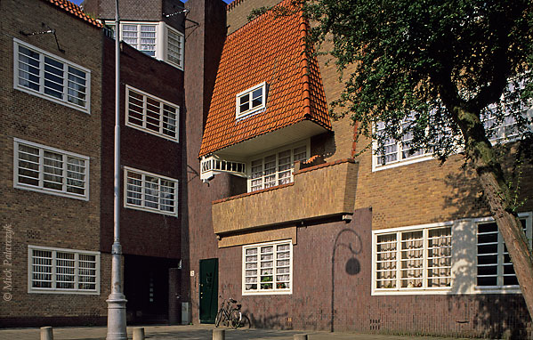 "[Amsterdam-5397]	 Amsterdam, P. L.Takstraat. Housing (1923) in ""Amsterdamse School"" style by architect P. Kramer. Photo Mick Palarczyk."
