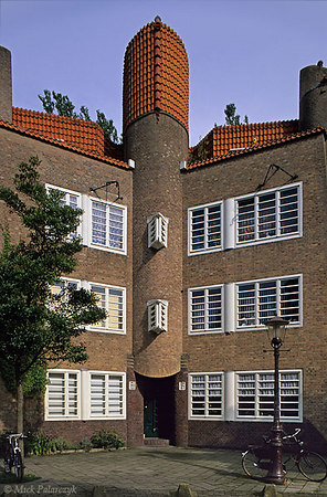 "[Amsterdam-5400]	 Amsterdam, P.L.Takstraat. Housing (1923) in ""Amsterdamse School"" style by architect P.Kramer. Photo Mick Palarczyk."