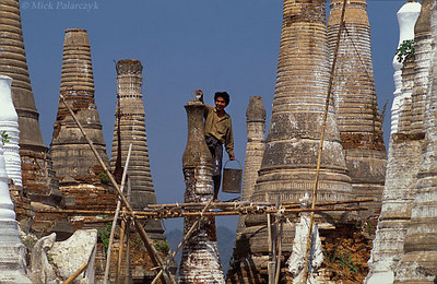 [BURMA 24.868] 'Restoring stupas.'	 At Indein, a village on the west shore of the Inle Lake, restoration work has started at the dilapidated Shwe Inn Thein Pagoda complex (founded in the 11th century). Photo Mick Palarczyk.