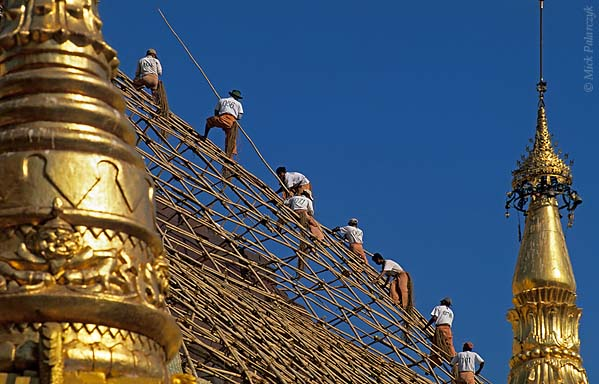 [BURMA 24.678] 'Building scaffolds at the Shwedagon Pagoda.'	 Workmen are covering the central stupa of Yangon's Shwedagon Pagoda in bamboo scaffolding so that the structure can be covered with a new layer of gold. Photo Mick Palarczyk.
