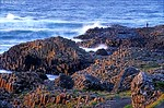 [BRITAIN.IRELANDNOR 21.851] 'Fin's bridge.'	 The basaltic rock columns of Giant's Causeway are battered by the Atlantic Ocean. According to myth the Causeway was built as a bridge to Scotland by the giant Finn, who wanted to test his strength against his Scottish rival Fingal.