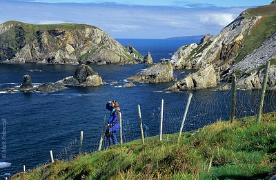 [IRELAND.DONEGAL 21.792] 'Coast at Port.'	 At Port, north of Glencolumbkille, sea-stacks and little islands give the Donegal coastline a dramatic appearance.