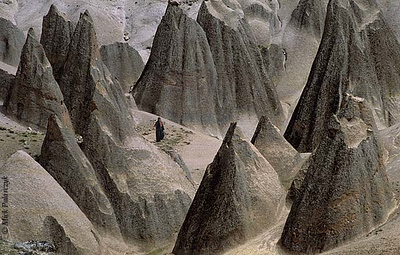 [TURKEY.CENTRAL 26938 'Tuff cones near Selime.'  	Sharply pointed rock formations of tuff (consolidated volcanic ash) create a weird landscape near the Cappadocian village of Selime, southeast of Aksaray. Photo Mick Palarczyk.