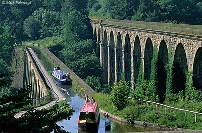 [BRITAIN.WALES 22.299] 'Chirk aqueduct.'	 The Chirk aquaduct, finished in 1801, takes the Llangollen Canal from England to Wales. On the right is a later train viaduct. Photo Mick Palarczyk.