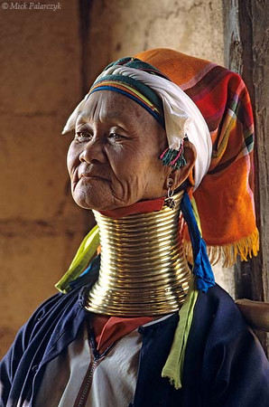 [BURMA 24.849] 'Donom, a Padaung woman (I).'	 Donom, a woman from the Padaung tribe, lives currently in Indein, a village on the west shore of the Inle Lake. She has sought refuge here from political unrest in her home Kayah State, which lies south of the Inle Lake. Photo Mick Palarczyk.