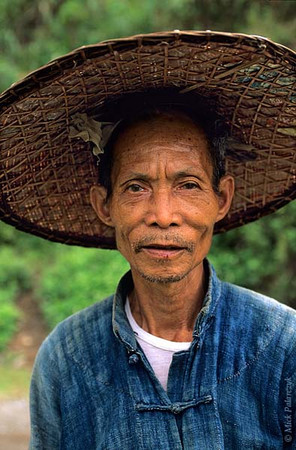 [VIETNAM.NORTH 21.376] 'White Thai villager.'	 North of Lai Châu, this old farmer from a White Thái village in the valley of the Na River is old enough to remember a few words of French from the colonial period. Photo Mick Palarczyk.