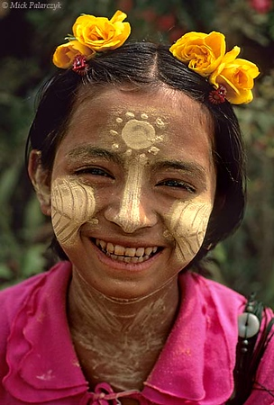 [BURMA 25.017] 'Girl at Inwa.'	 At Inwa, the former royal city south of Mandalay, a girl is showing off her thanaka make-up. Photo Mick Palarczyk.
