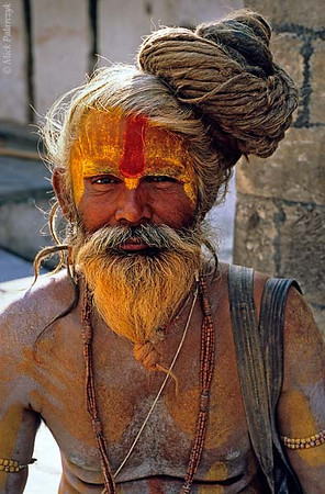 [NEPAL.KATHMANDUVALLEY 27297] 'Holy man at Pashupatinath.'  	Kathmandu's Pashupatinath Temple is a favourite spot for holy men (sadhus) to linger. Photo Mick Palarczyk.