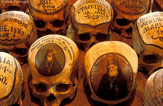 <h4>[ROMANIA.MOLDAVIA 24.125] <br>'Lively skulls.'	</h4> Some of the skulls in the ossuary of the 15th century Neamt Monastery have little paintings showing their owners in life. Others simply state their names and dates. Photo Mick Palarczyk.