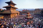 [NEPAL.KATHMANDUVALLEY 27450]<br /> 'Tug-of war in Bhaktapur.'<br /> <br /> Bhaktapur's New Year's festival (Bisket) starts with a tug-of-war in Taumadhi Square, in which residents of the upper and lower halves of the city try to pull a chariot to their respective sides. The enormous temple shaped rath (vehicle of the gods) contains a mask of the god Bhairava, which is normally kept in the temple that is visible on the left. Photo Mick Palarczyk.