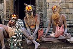 [NEPAL.KATHMANDUVALLEY 27291]<br /> 'Holy men at Pashupatinath.'<br /> <br /> 	Kathmandu's Pashupatinath Temple is a favourite spot for holy men (sadhus) to linger. Photo Mick Palarczyk.
