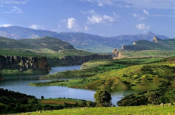 [TURKEY.EAST 27875] 'Euphrates valley west of Siverek.'  West of Siverek, a view northward along the Euphrates valley leads the eye to the distinctive Taurus peak of the Kimil Tepe (1222m) on the horizon. Photo Mick Palarczyk.
