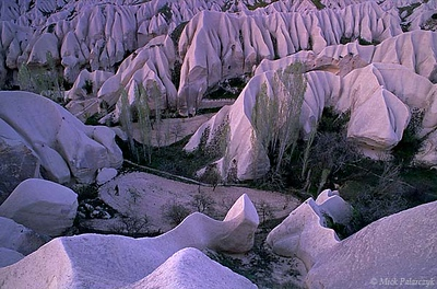 [TURKEY.CENTRAL 26895 'Zindanönü Valley.'  	In the Cappadocian Zindanönü Valley, east of Göreme, small fields are surrounded by razor sharp ridges of white tuff. The tuff was deposited in the form of ash by nearby volcanos between 11 and 3 million years ago. Photo Mick Palarczyk.