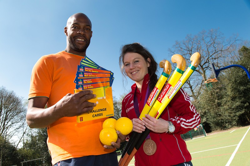 Olympic medallist Laura Unsworth who is leading pupils at her old school through a hockey session - L to R - Ian Webber (PE Co-Ordinator), Laura Unsworth