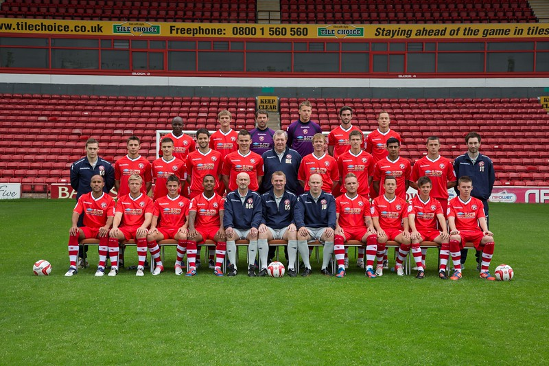 Walsall FC - Back row L to R - Febian Brandy, Connor Taylor, James Walker, David Grof, Will Grigg, Kieron Morris.  Middle Row L to R - Kane Georgiou (Assistant Physio), George Bowerman, Jamie Paterson, Ben Purkiss, Andy Butler, Mick Kearns (Community Director/Goal Keeping Coach), Dean Holden, Paul Downing, Malvind Benning, Aaron Williams, James Troop (Analyst).  Front Row L to R - Adam Chambers, Nicky Featherstone, Florent Cuvelier, Ashley Hemmings, Richard O'Kelly (Assistant Manager), Dean Smith (Manager), John Whitney (Physio), Richard Taundry, Ben George, James Baxendale, Jake Jones.